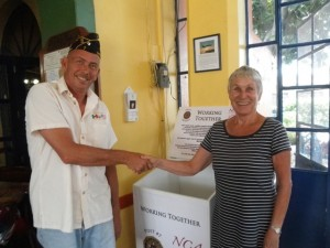 American Legion Post 7 Commander Timothy Stern and Lori Skoda, Niños de Chapala and Ajijic Bazaar Director seal their agreement to place a donation drop box in Chapala Post 7.